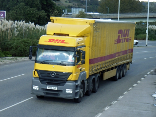 """""""DHL-AY06EYR"""" by Graham Richardson from Plymouth, England - DHL AY06EYRUploaded by oxyman. Licensed under CC BY 2.0 via Wikimedia Commons - http://commons.wikimedia.org/wiki/File:DHL-AY06EYR.jpg#/media/File:DHL-AY06EYR.jpg"""